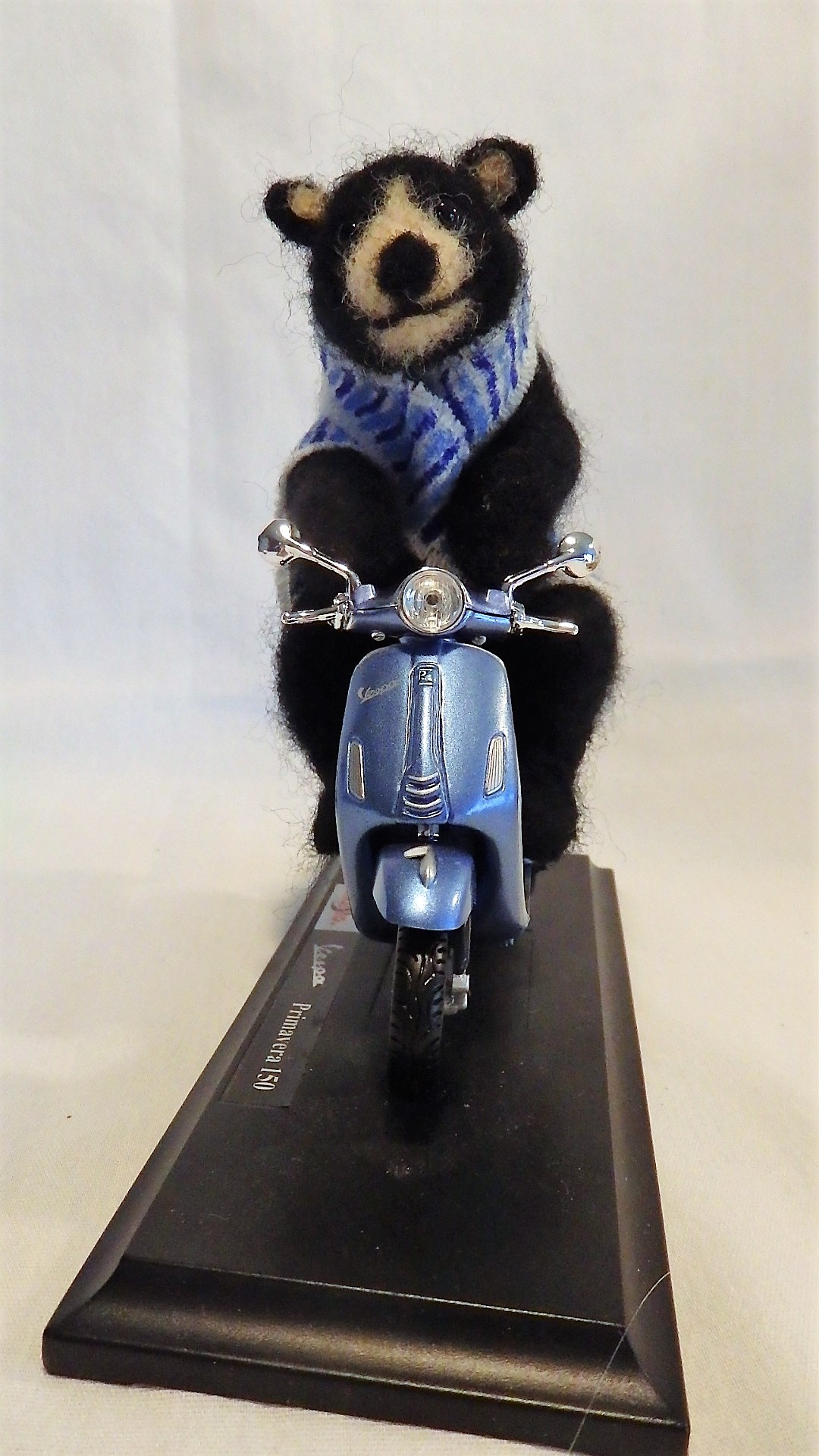 """""""Maine"""" black bear on scooter"""