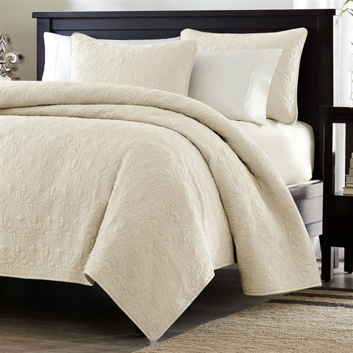 This Twin / Twin XL size Quilted Coverlet Set with One Pillow Sham in Ivory is the perfect coverlet to use as a layering piece or an alternative to your comforter for a new solid look. The classic stitch pattern pairs easily with your existing décor and will sure to add a new decorative element to your bedroom. The coverlet has 100% cotton fill and the face and the reverse of the coverlet are a super soft brushed fabric.