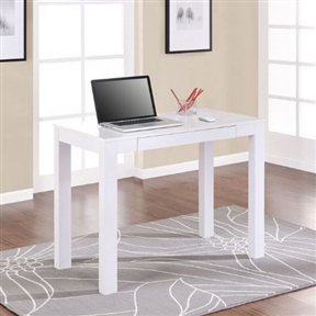 This Simple Home Office Computer Laptop Desk with Drawer in White is a simple and classic design. The desk can easily fit with any décor in your house. Place this desk in any of room in your house to help keep your home office organized. Convenient pull out drawer helps to hide papers, pencils, or other office supplies. Perfect for small spaces and very easy to assemble, many of our customers love the ease and light weight of this desk. It's versatile and can be used in the kitchen as well as the dorm room! Free Shipping should make life even a little easier.