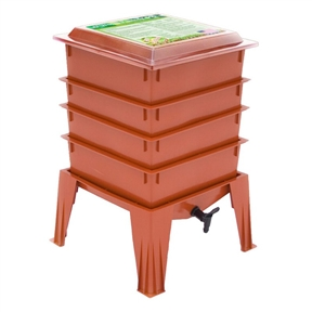 Terra Cotta Composter Worm Compost Bin Made from Food Grade Plastic, WFTC871563 : This Terra Cotta Composter Worm Compost Bin Made from Food Grade Plastic features a thicker, sturdier design with an improved base and lid. And the new Terra Cotta color looks great in any outdoor setting. This composter can hold up to 8 trays instead of 7, and it includes a handy compost accessory kit, featuring a coir brick, hand rake, scraper, and thermometer, which make maintaining your system cleaner and easier. It even comes with an instruction video that's great for beginners. Odorless operation with Thermo Siphon Airflow design; Recycles kitchen waste and junk mail into compost; Use indoors during winter and outdoors in summer; Improved lid and base design; 20-year warranty on parts and workmanship. New Terra Cotta color looks great in the backyard; Unique, self sorting upward migration worm bin; Made in the USA from 100% food-grade virgin plastic.