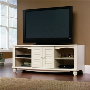 This White TV Stand Entertainment Center - Holds up to 62-inch TV has the hardworking side of the cottage pedigree. The collection offers genuine functionality for every room in the house providing an option for the family room that is sized to fit the latest in home electronics.