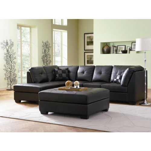 """Designed with a lengthy chaise on its right and a three-seat armless sofa on its right, this Black Faux Leather Sectional Sofa with Left Side Chaise offers plenty of room for sitting and socializing. Upholstered with thick box-faced seat cushions and plush button-tufted back pillows, this sectional is built for your leisure, offering sleep-worthy comfort and effortless support no matter where you sit. With its crips lines, block wood feet, and black leather upholstery, this sectional exudes a sleek contemporary style that will bring casual elegance to any room. Topped with matching knife-edge throw pillows for added style and support, this sectional will quickly become everyone's favorite place in the house."""""""