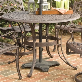 42-inch Round Patio Dining Table in Rust Brown Metal with Umbrella Hole, RBMPT8968418 :   Add a hint of style to the backyard, lawn, deck, or patio with this 42-inch Round Patio Dining Table in Rust Brown Metal with Umbrella Hole. This stylish dining table has an intricately designed metal work that gives it an elegant charm that makes it unique from the rest. The outdoor dining table is round and can be coupled with matching chairs for a wholesome look. Designed for the outdoors, this 42-inch Round Patio Dining Table in Rust Brown Metal with Umbrella Hole is made from premium materials that keep it strong and sturdy for years to come. The dining table has a non-toxic powder coated finish that does not fade away easily. It is available in multiple finish options, so you can choose the perfect one for your home or office without much hassle. Even the table top is available in multiple sizes. The nylon glides on all table legs keep it stable on the ground and does not tilt or wobble. This dining table sports a lovely top that has center opening to accommodate umbrella, ensuring protection from the harsh sunlight or rain. This beautiful dining table is easy to clean and maintain. Regularly wipe the end table with a dry, clean cloth and it will look new for long. Durable, lasting year after year; Maintenance free; Cast aluminum construction; Water Resistant Details: Table top's design prevents damage caused by pooling by allowing water to pass freely; Product Warranty: One Year Limited Manufacturer Warranty; FSC Certified: Yes.