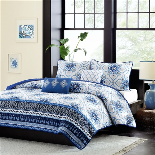 The Twin / Twin XL size Blue White Floral Lightweight Coverlet Set will bring an elegant look to your bedroom. Varying blue and gray prints run along the bottom, and a dark blue border outlines the coverlet creating dimension and depth. Made from polyester and a cotton filling, this coverlet is machine washable for easy care. Two white and blue decorative pillows with embroidered details complete the look.