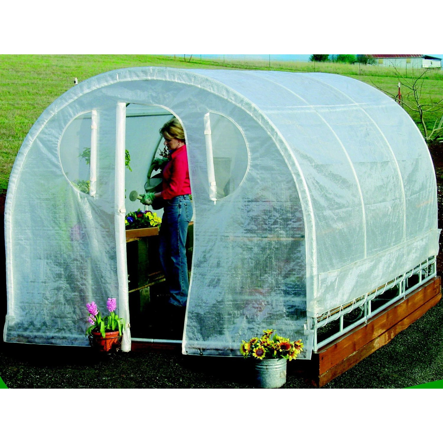 Polytunnel Hoop House Greenhouse (8' x 12'), PTHSG8X12 :   Designed as the highest quality, most compact, space saving greenhouse packaged in a retail box. This Polytunnel hoop-house cold-frame style High-Tunnel greenhouse features a space saver design.  The modern greenhouse offers all of the same quality, workmanship, and results as the Commercial Series Green House while appealing to beginner, novice, and professional growers alike. Each Deck and Patio greenhouse is constructed from 100 percent commercial grade galvanized steel frame. Featuring quick connect steel frame and steel frame connectors. It includes a rugged all weather triple layer Polyurethane, cover, back panel, and front entry. Rust resistant galvanized steel. The frame components and frame connectors are galvanized after being welded. This Greenhouse provides maximum protection, growth, and reliability by using a complete three piece all growth fabric construction with unit-body cover, solid connected back panel, and solid connected front entry – allowing for easy access and maintenance of plants, vegetables and herbs. It also utilizes Smart Vent – technology controlling airflow from the base of the unit and the ends of the unit with special zip out Velcro held screened vented windows. In addition the triple ridge reinforced roof structure not only acts as a weather guardian protecting against severe and inclement weather but also allows growing enthusiasts to hang their full size basket plants from the roof of the green house. All-steel construction with flex frame design and 1-1/4-inch, 16-gauge steel for stability. 14-gauge inside steel slip fitting joints for rugged rigidity and easy setup.