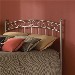 This Full-size Arched Metal Headboard in New Brown Finish is a beautiful piece that will add style and class to any bedroom. The arched headboard includes S-shaped details that give the metal bed a soft feel. This headboard will fit perfectly in any sleeping space. Assembly Required: Yes; CPSIA or CPSC Compliant: Yes;  ISTA 3A Certified: Yes; General Conformity Certificate: Yes; Frame Material: Metal Powder Coated Finish: Yes; Non-Toxic: Yes; Finished Back: Yes; Frame Required: Yes; Drill Holes for Frame: Yes; Product Care: Wipe with a clean, damp cloth.