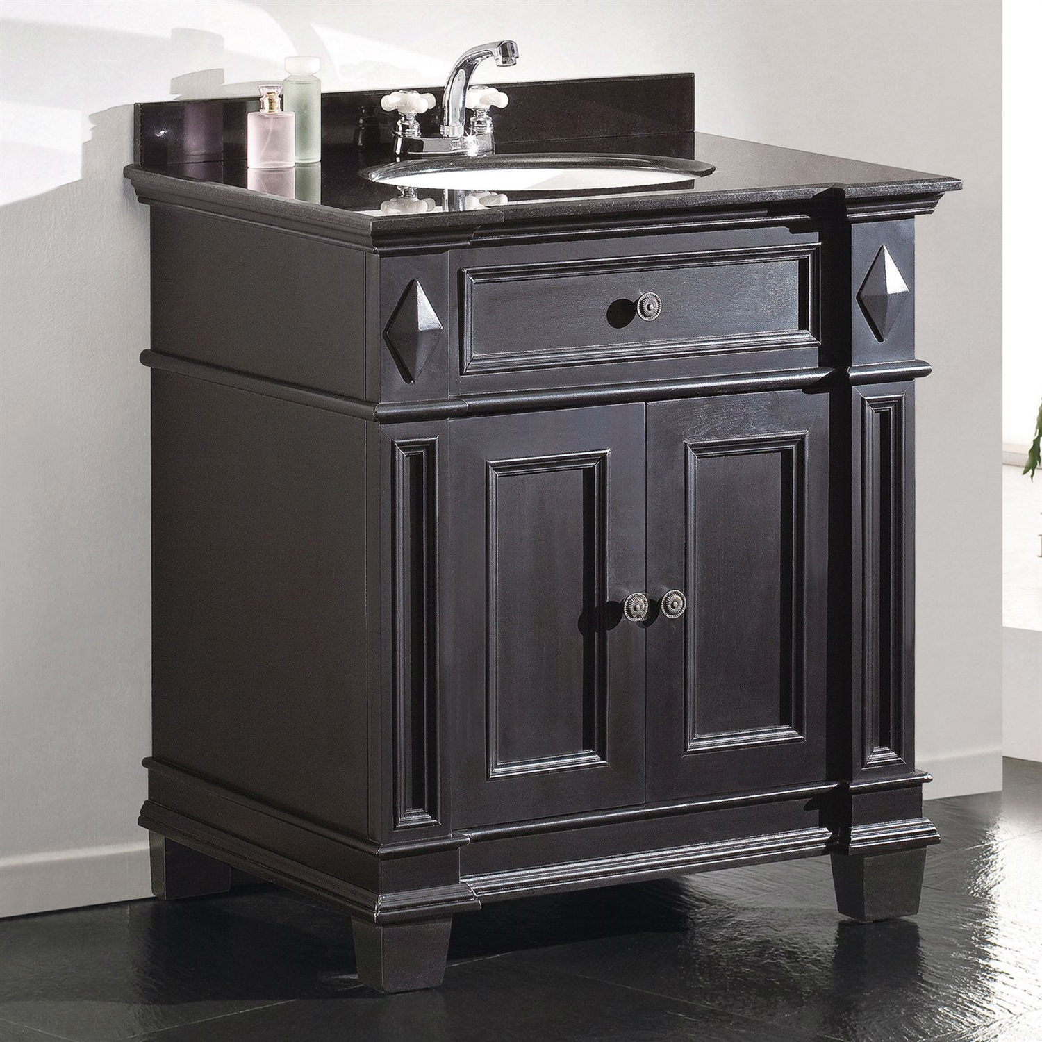 Single Sink Bathroom Vanity with Cabinet & Black Granite Countertop / Backsplash, ODE65915 :  This Single Sink Bathroom Vanity with Cabinet & Black Granite Countertop / Backsplash is a simple way to breathe new life into your bathroom décor. Its stunning cabinet base is made from sturdy, solid wood, featuring a two-door storage area built into the design. The piece is finished in an antique black and features solid metal hardware with a nickel finish. A black granite countertop is included, pre-drilled for a 4-inch minispread faucet assembly and paired with a white ceramic oval undermount sink basin; faucet assembly is not included. A complementary backsplash is included. Close Hinges, Soft Close Slides, Backsplash; Antique Hardware; Hardware Included Yes; Installation Free; Standing Material Wood; Undermount; Number of Doors 2; Number of Shelves 1; Sink Oval Sink Color; Traditional Type; Full Bathroom; Vanity Set Warranty 1 Year.