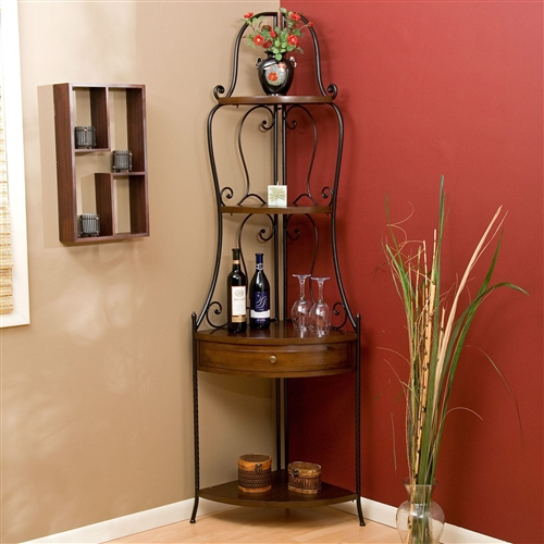 Fine retailers will offer the same high-quality of this Space Saving Corner Bakers Rack with Wrought Iron Frame, but they can't beat this price. An excellent value, this bakers rack features a durable black wrought iron frame with decorative scrolls and curves. Four shelf surfaces and one drawer are all constructed of pine wood and feature a shining Heritage Oak finish to take this rack to the next level of quality. You'll appreciate how the corner design of this bakers rack saves you on floor space without compromising on storage capabilities. You'll be amazed at how much you can store on this attractive piece.