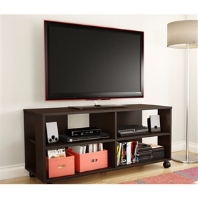 This Contemporary TV Stand Cart with Casters in Chocolate Finish is a versatile, flexible storage unit on casters that works as a combination TV stand/storage piece. The four open spaces make it ideal for putting away electronics as well as everyday items. Because of the casters, this unit is easy to move around and therefore practical and functional, no matter how it's used. The straight lines and trendy design make for a contemporary style that will go nicely with the other furniture in the room. Open storage spaces separated by fixed shelves, perfect for electronic devices and everyday items; Cut out hole in the back panel which allows for easy wire management; Back surface is not laminated; Storage unit on casters; Accommodates LCD and plasma televisions up to 48 inch