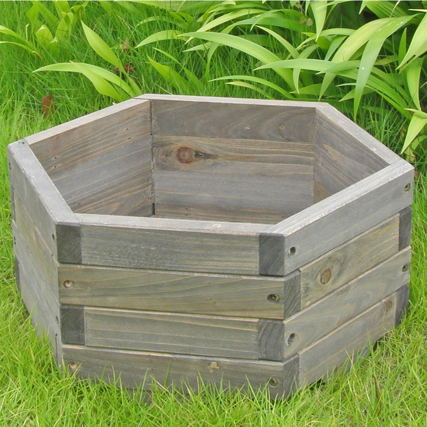 Small 16 x 16 x 7-inch Hexagon Fir Wood Garden Planter Box, EXGBP3616 :  This Small 16 x 16 x 7-inch Hexagon Fir Wood Garden Planter Box would be a great addition to your home. It has a hexagon shaped garden barrel and is functional and practical. Made of Chinese fir which has the natural resistance to moisture, decay, and insect damage and is highly durable and scented; Functional and practical to use it indoors and out on patios, decks and lawns; Indoor Use: Yes Assembly Type: Assembly required; Product Warranty: 90 days warranty, Free of Manufacturer defects, free replacement for damaged parts within warranty terms Material: Chinese Fir; Drainage Holes: Yes Insect Resistant: Yes; Warp Resistant: Yes Rot Resistant: Yes; Distressed: Yes Recycled Content: 0%.