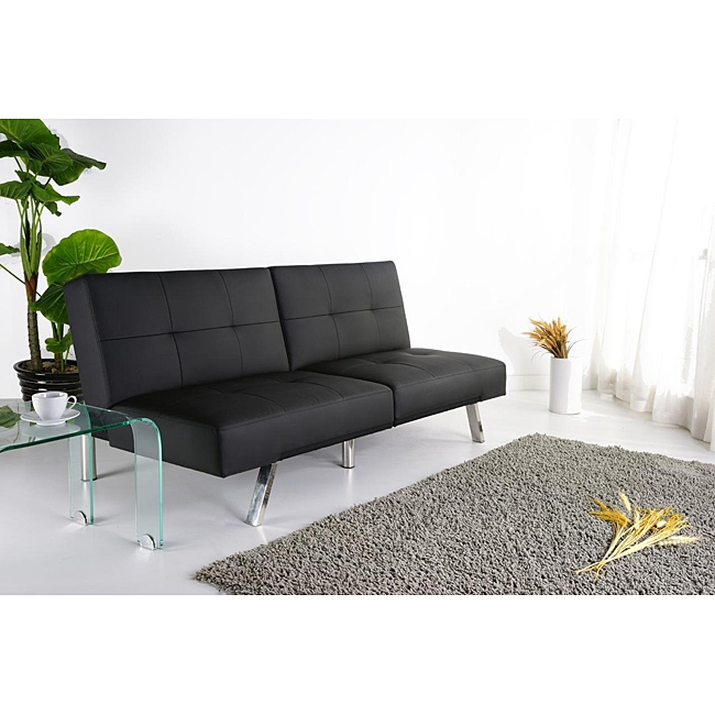 This Black Leatherette Foldable Click-Clack Futon Sofa Bed has a solid wood construction and black PU leatherette upholstery with detailed stitching. It features a convenient click-clack mechanism to convert the sofa into a comfortable bed within seconds. This black sofa bed includes a split seat back and sleek chrome legs. Multi-functional, contemporary style highlights this Jacksonville foldable futon bed. This Click-Clack sofa bed features black leatherette upholstery and a split seat back.