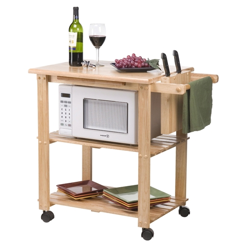 This Solid Wood Kitchen Utility Microwave Cart with Pull-Out Cutting Board adds working and storage space to your kitchen or dining area. This versatile kitchen cart is composed of a solid Beechwood structure with a soft natural wood finish. It features a pull out cutting board, towel holder and knife holder. It also has two visible lower shelves for convenience. The measurement below is without the cutting board pulled out. The height from the middle shelf to the top is 11.25 inches, and the height from the bottom shelf to the middle shelf is 12.75 inches.