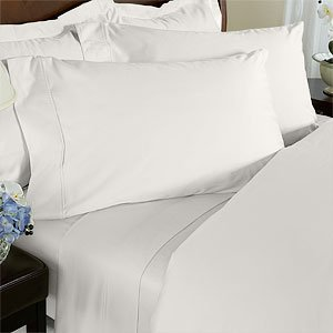 "Royal Tradition. Wrinkle-resistant 300TC Solid 100% Egyptian Cotton Linens. The 4-Piece Sheet Set starts with amazingly soft single-ply 300 thread-count 100% cotton sateen that has a wrinkle resistant finishing treatment and has been calendared and mercerized. The benefit to you is sheets and pillowcases that have a beautiful sheen, higher luster, increased durability and are smoother to the touch. The flat sheet and pillowcases are accented with a decorative turn back hem to add strength and give them a clean, crisp look. Deep Pocket Fitted sheet to fit up to 18"" Mattress Fitted Made with Elastic all around for better fit. Machine Wash."