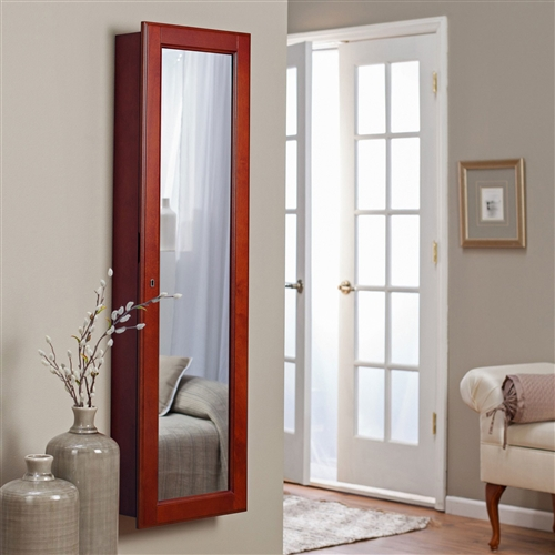 Wall Mounted Locking Jewelry Armore with Mirror in Cherry Wood Finish,  BLWMLA1896815 :  This Wall Mounted Locking Jewelry Armore with Mirror in Cherry Wood Finish reflects your good taste in home decor as well as your smart ensemble. Once you've chosen the best accessories for your outfit from the selection stored inside, you'll use the mirror for a final glance as you depart for work, an evening out with friends or any other occasion. Traditional in style, finished in an elegant cherry hue, yet modern with its LED lights tucked inside this casement for easy accessory selection, this space-saving piece of furniture will provide organization to your treasured pieces. The numerous hooks, trays, shelves and slots will store necklaces, earrings, rings, bracelets, watches, pins and more, nestled against the soft, felt-lined interior. 40 jewelry hooks, 10 ring slots, 3 removable trays; Uses 4 D batteries; Style Traditional, Mission, Louis Philippe, Girls and Teens; Ships fully assembled. No assembly required.