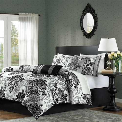 This Queen size 7-Piece Damask Comforter Set in Black White Grey would be a great addition to your home. It has a black/grey color and a Damask pattern. Material: 100% Polyester; Poly fill. Country of Manufacture: China.