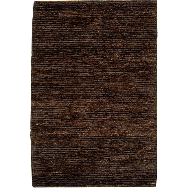 Hand-knotted All-Natural Earth Brown Hemp Rug (9' x 12'), HKANHR9X12 :  Fashion meets sustainability in this Hand-knotted All-Natural Earth Brown Hemp Rug (9' x 12'). This floor rug is hand-knotted of 100-percent high-quality jute pile on a cotton warp and weft with a fringed border. The all-organic rug is brown in color. All rug sizes are approximate. Due to the difference of monitor colors, some rug colors may vary slightly. Overstock.com tries to represent all rug colors accurately. Please refer to the text above for a description of the colors shown in the photo. Tip: We recommend the use of a non-skid pad to keep the rug in place on smooth surfaces. Pile height: 0.5 inches; Style: Casual; Primary color: Brown; Pattern: Solid.