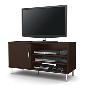 This Contemporary TV Stand in Chocolate Brown Finish with Metal Legs is an affordable choice that will add a contemporary style to your décor with its simple line and metal legs in a silver finish. On the left side there are 2 closed storage spaces behind the door which comes with an elegant metal handle in a silver finish, separated by an adjustable shelf. On the right side, 3 more open storage spaces separated by 2 adjustable shelves to settle your electronic devices. Each adjustable shelf can support a weight up to 15 lbs. It can accommodate a television up to 48 inch and its weight capacity is 80 pounds. It is also available in Pure Black finish. It measures 46-1/4-inch wide by 18-1/4-inch deep by 24-inch high. For complete interior dimensions, see spec sheet. It is delivered in a box measuring 56-3/4-inch by 19-1/2-inch by 4-inch high. The back is not laminated and comes with a hole for cable management. Accessories not included. Manufactured from certified Environmentally Preferred laminated particle panels. Complete assembly required by 2 adults. Tools are not included. 5-year limited warranty. Made in Mexico.