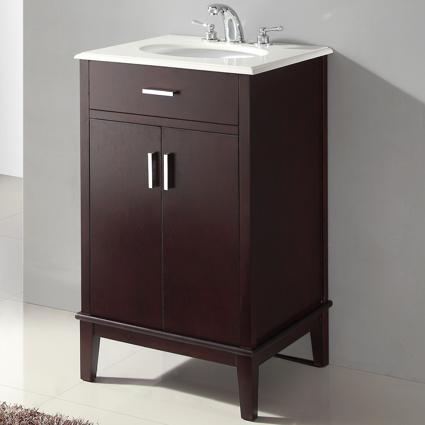 "21"" Single Bathroom Vanity Set in Espresso with White Quartz Top, SHU338291 :  This 21"" Single Bathroom Vanity Set in Espresso with White Quartz Top would be a great addition to your home. It has a contemporary design and a white quartz top. Bombay white quartz top; Oval undermount sink; Birch hardwood frame and legs; Side mounted ball bearing drawer slides; 105 Degree hinges on storage doors; Top pre-drilled for 4"" faucet; Faucet not included; Finish: Dark espresso brown stain; False drawer (does not open); Manufacturer provides 1 year warranty, limited to manufacturer defects. Base Finish: Dark Wood; Sink Type: Undermount; Top Finish: Brown; Base Material: Wood; Number of Sinks: 1; Mounting: Free-standing; Doors Included: Yes; Drawers Included: No; Sink Included: Yes; Country of Manufacture: China."