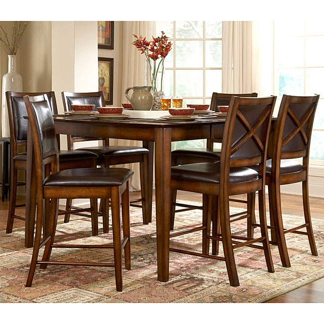 This San Francisco 5-Piece Dining Set in Rustic Oak Finish features a durable Asian rubberwood construction with an oak veneer table top with walnut inlays and a distressed rustic oak finish. These stools are upholstered in a luxurious deep chocolate bi-cast vinyl.