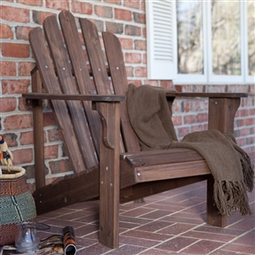 Durable Fir Wood Adirondack Chair with Armrest in Dark Brown, DBC6848771 :  You can't help but feel relaxed when you're sitting pretty in this Durable Fir Wood Adirondack Chair with Armrest in Dark Brown. The beautifully rustic chair is crafted from sturdy yet lightweight fir, chosen specifically for use in outdoor furniture because of its natural ability to stand up to the weather and take a beating from Mother Nature. Finished in a dark-brown stain that lends it country flair, this chair has a generously sized seat and contoured back that beckon you to sit down and take it easy. Dark brown stain highlights wood's natural beauty; Contoured seat and wide armrests; Comfort back for hours of relaxation; Surface Stained; Wood Type Fir.