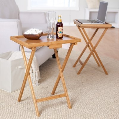 This Set of 2 Bamboo Wood TV Table Snack Coffee Tables in Natural would be a great addition to your home. Lipper International has developed a complete line of woodenware products consisting of tableware, salad bowls, storage items, pantry ware and home organization items. These collections are continually refined and expanded. Discover a wide variety of practical, yet beautiful kitchen amenities designed to help you organize the practical side of your kitchen and pantry. From napkin and towel holders to spice racks and recipe boxes, simply select your favorite collection and add a decorative touch to every aspect of your room.