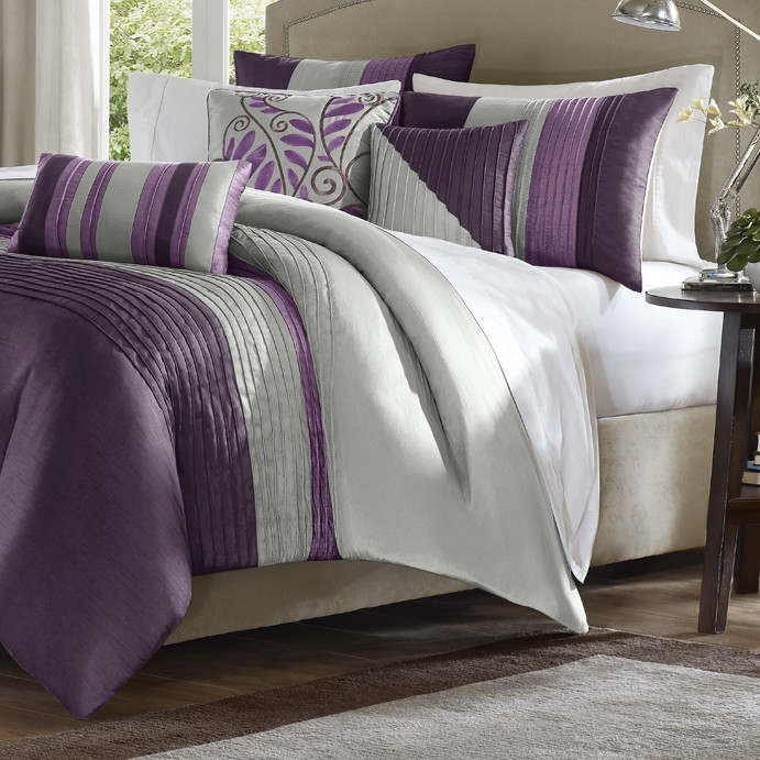 Update your bedroom settings with this King size Bed in Bag Comforter Set Amethyst Plum Purple Gray Stripes. Its impressive design is a blend of causal style with contemporary aesthetics. This stunning set can fit well with your bedroom settings or your guest room interiors. It can prove to be a thoughtful and useful gifting option. The comforter set features clean lines and stripes that add a touch of subtle elegance to its overall look. This gorgeous set includes a comforter, 2 shams, bed skirt and 3 decorative pillows. It features a sleek piping of the fabric on the comforter that adds to its charm. It's decorative and accent pillows lend a strong visual dimension. The floral pillow makes its unique design look even better and adds a touch of softness to its attractive and minimalist look. It is pieced with good quality polyester dupioni to ensure its durability. The elegant pillows are intricately embroidered which enhances its sophisticated look. The high quality polyester jacquard and brushed polyester back accentuate its durability. It is very easy to clean and maintain for many years to come. This set's lovely design can complement a traditional as well as contemporary decor setting with ease.