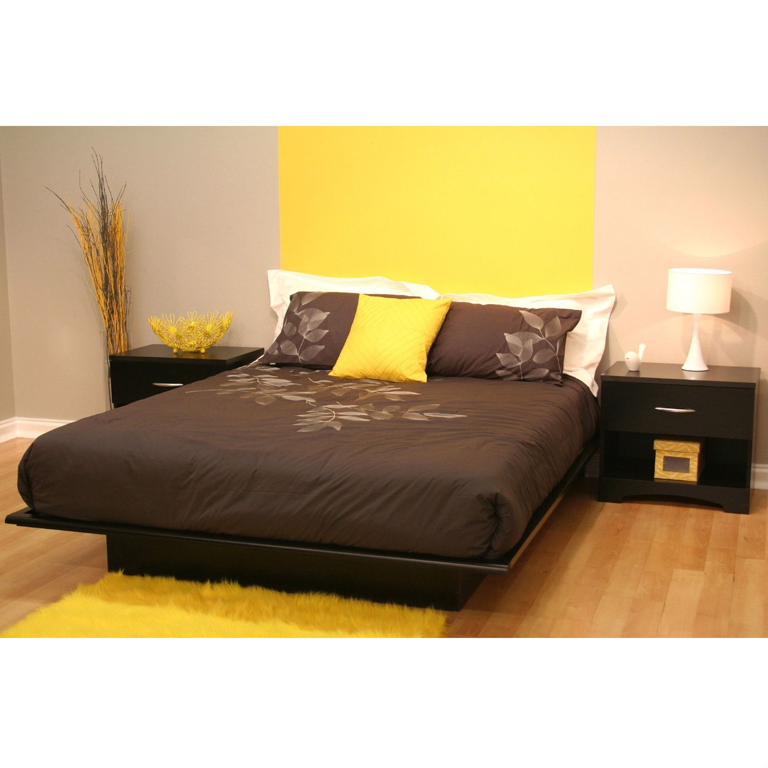 Queen size Modern Platform Bed Frame in Black Wood Finish, QBPBS18208 :  Simple and elegant, this Queen size Modern Platform Bed Frame in Black Wood Finish looks fabulous and adds contemporary styling to any room. Manufactured in Canada, this platform bed is crafted with superior quality materials. To ensure that the mattress always stays in place, the moldings of this bed are crafted with profiled edges. Constructed from Eco-friendly, EPP-compliant laminated particle board, this bed is sure to stay tough for years. It's gorgeous black finish blends well with your interiors and has a rich texture. Made from non-toxic materials and components, this South Shore Lexington Collection Platform Bed ensures a healthy environment for you and your family. Being FSC certified, this modern style bed has not contributed towards deforestation or exploitation of wood workers. It is CARB compliant and is ISTA 3A certified for safety during transportation. This bed from Lexington collection is available in three different sizes and has a weight limit of over 500 lbs. It does not require a box spring and is not drilled to accommodate headboards. All in all, this platform bed is a great combination of stunning looks and functionality. This beautiful bed is available in different sizes, so that you pick the best one that goes with your bedroom. 5-year manufacturer's limited warranty; Assembly Required: Yes; CPSIA or CPSC Compliant: Yes; Country of Manufacture: Canada; Eco-Friendly: Yes; Weight Capacity: 500lbs. Product Care: Wipe clean with dry cloth.