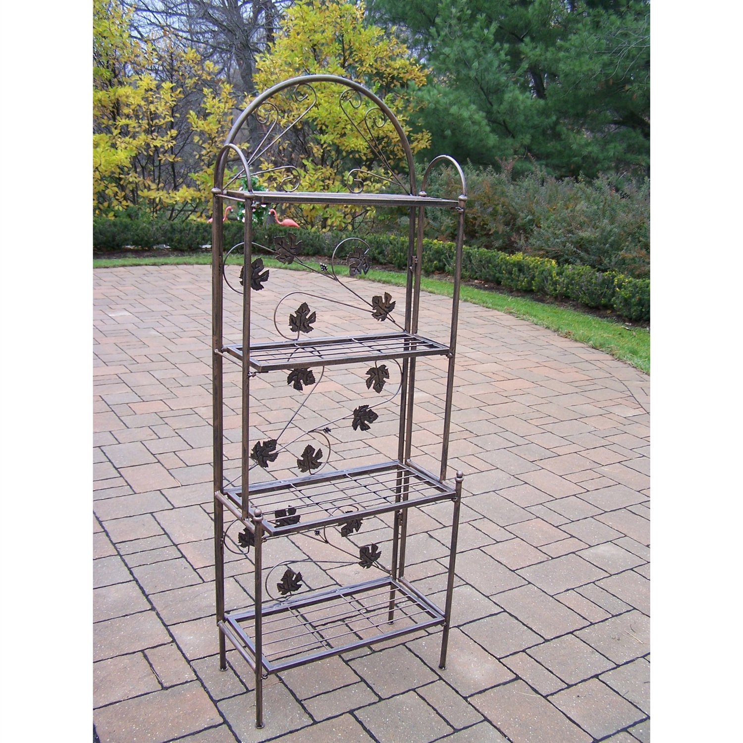 This Cast Iron Bakers Rack with Grape Vine Design in Antique Bronze is the perfect edition to any setting. Adds beauty and style both indoors and out while having functionality. Features a hardened powder coat finish for years of beauty. Distressed: No; Number of Tiers: 4 Tiers; Product Category: Baker's Racks; Style: Traditional; Type: Standard