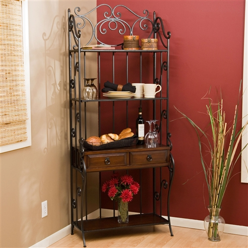 You can't call yourself a real foodie chef if your cooking and baking supplies are stuffed into old drawers and cabinets. That's where this Black Wrought Iron and Walnut Wood Finish Bakers Rack comes in. This rack is the perfect housing unit for a busy cook's tools of the trade. The stunning, intricate wrought-iron frame lends a classic feeling to the rack, while the shelving made of walnut-tinted MDF and pine imparts a rustic feel. The rack's drawers come equipped with exquisite, antique-inspired drawer pulls made of iron, and you don't have to worry about roughly yanking them while on the hunt for an errant rolling pin thanks to convenient, smoothly-sliding drawer pulls.