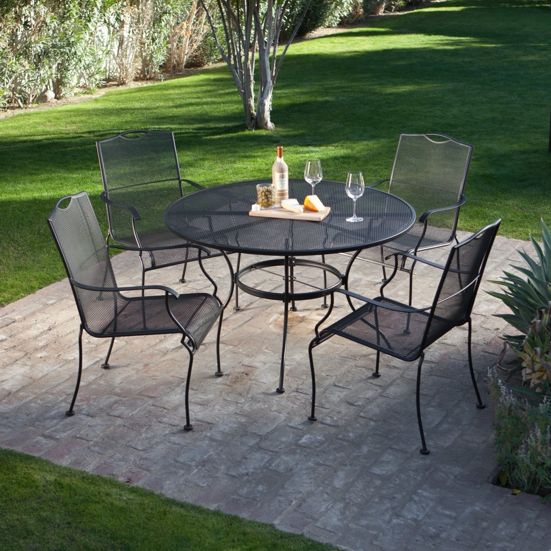 5-Piece Wrought Iron Patio Furniture Dining Set - Seats 4, WDS4S689 :  Big on comfort and smart in style, this 5-Piece Wrought Iron Patio Furniture Dining Set - Seats 4 - Seats 4 will grace your poolside or patio, bringing even more enjoyment to cozy family dinners or casual meals with friends. Characterized by a simple, yet elegant design, clean lines, and textured black powder-coat finish that goes beautifully with most outdoor settings, these four chairs will envelop you in comfort all through the meal. This micro mesh table, also in a textured black powder-coat finish, goes beautifully with most outdoor settings. It's 48 inches around to comfortably accommodate the four chairs. It's even equipped with an umbrella hole, so it's ready for a patio umbrella for those particularly hot days. 1-year residential and commercial warranty;     Chairs require no assembly, table requires minor assembly.