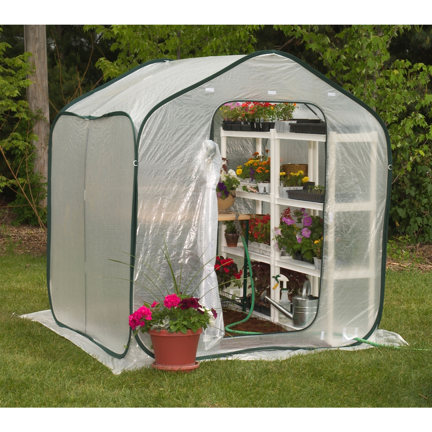 Spring Gardener Flower-House Lightweight Greenhouse (6' x 6'), WFSHG128351 :  The Spring-House is perfect for improving climatic conditions in all geographic locations. The greenhouse environment makes it easier to keep your plants green. Now your plants can bloom earlier with a head start on the Spring and Summer months and you can garden year-round. The SpringHouse design is compact and lightweight for easy transport, setup and take down. Only minimal assembly is required. Two screened doors double as vents to provide optimum air circulation. All Flower-House greenhouses are constructed with the incredibly durable Grow-Tec material. Grow-Tec is UV resistant, weatherproof and features rip stop protection.  Four convenient accesses for water hose or power cord; Comes with instruction manual and greenhouse guide; Ground stakes, tie-downs, shade cover, and carry pack included. Night time temperatures inside your Flower-house greenhouse will drop to outside temperatures without an additional heating source; 1 year limited warranty; Please Note: Warranty is not valid until the warranty card is filled out and returned within 14 days of purchase; Built in Vents, No Foundation Needed, Portable, Lightweight; Type: Hobby Greenhouse; Home Gardener; Panel Material: Polyethylene; Wind tested up to 60 MPH winds.