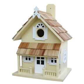 "Yellow Victorian Cottage Wood Outdoor Birdhouse, VCB3008Y :  A pine shingled roof, a covered porch and ""Cottage"" styling give this Yellow Victorian Cottage Wood Outdoor Birdhouse plenty of charm. A removable back wall, drainage, ventilation, an unpainted interior and a 1-1/4-inch hole size will invite nesting birds in and keep larger ones out. House can be hung with mounting peg (included)."