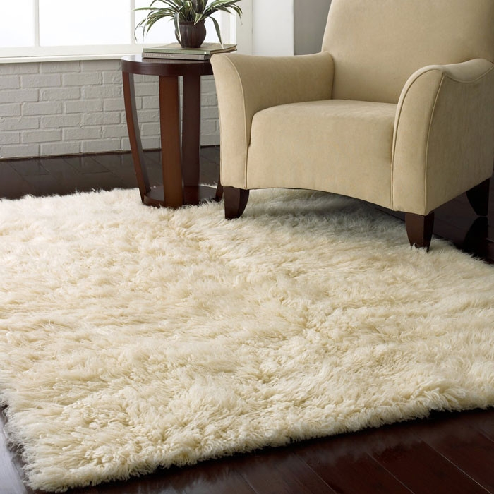 3.5-ft x 5.5-ft Hand Woven Wool Flokati Area Rug in Natural Color. LRFNR9902:  This 3.5-ft x 5.5-ft Hand Woven Wool Flokati Area Rug in Natural Color would be a great addition to your home. Hand woven of 100% New Zealand wool, this area rug is a masterpiece for any home. Product Care: Vacuum regularly. Spot clean with mild detergent and damp cloth. Product Warranty: 30 days free of manufacturer's defects; Construction: Handmade; Technique: Hand woven; Primary Pattern: Solid; Primary Color: Natural; Border Material: Wool; Border Color: Natural. Type of Backing: Cotton; Material: Wool; Rug Pad Needed: Yes; Recycled Content: 0%; Country of Manufacture: Greece.