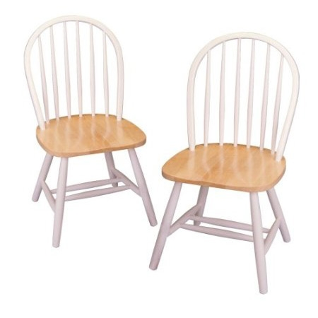 This one never goes out of style...This Set of 2 - Classic Wood Dining Chairs in Natural & White is both invitingly familiar and, with a fresh paint job, new all over again. Sold in a set of two, each chair features a generous fan back made of round posts and a solid, roomy seat that's comfortable with or without a chair pad. The thick, wide-set legs provide tip-free support, while a double stretcher adds extra strength and a nice design touch. Crafted of solid beechwood with a natural and white color palette, this pair looks wonderful gathered around a traditional or country kitchen table and also works as charming seating in the foyer, bedroom, or dining room.