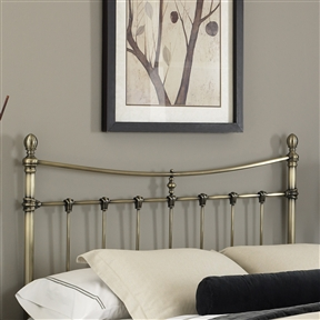This King size Meal Headboard in Antique Brass Finish combines elements of classical European baroque architecture with the simplistic style of the Modernist period. Straight-lined spindles are accented with ornamental scalloped castings, and rounded posts are completed with delicate foot castings and finials. Warm your bedroom space with touches of old and new style with this headboard. CPSIA or CPSC Compliant: Yes; Gloss Finish: Yes; Finish: Glazed antique brass; ISTA 3A Certified: Yes; Hardware Finish: Antique Brass; Distressed: Yes; Frame Material: Metal. Non-Toxic: Yes; Finished Back: Yes; Frame Required: Yes; Drill Holes for Frame: Yes; Product Care: Wipe with a clean, damp cloth.