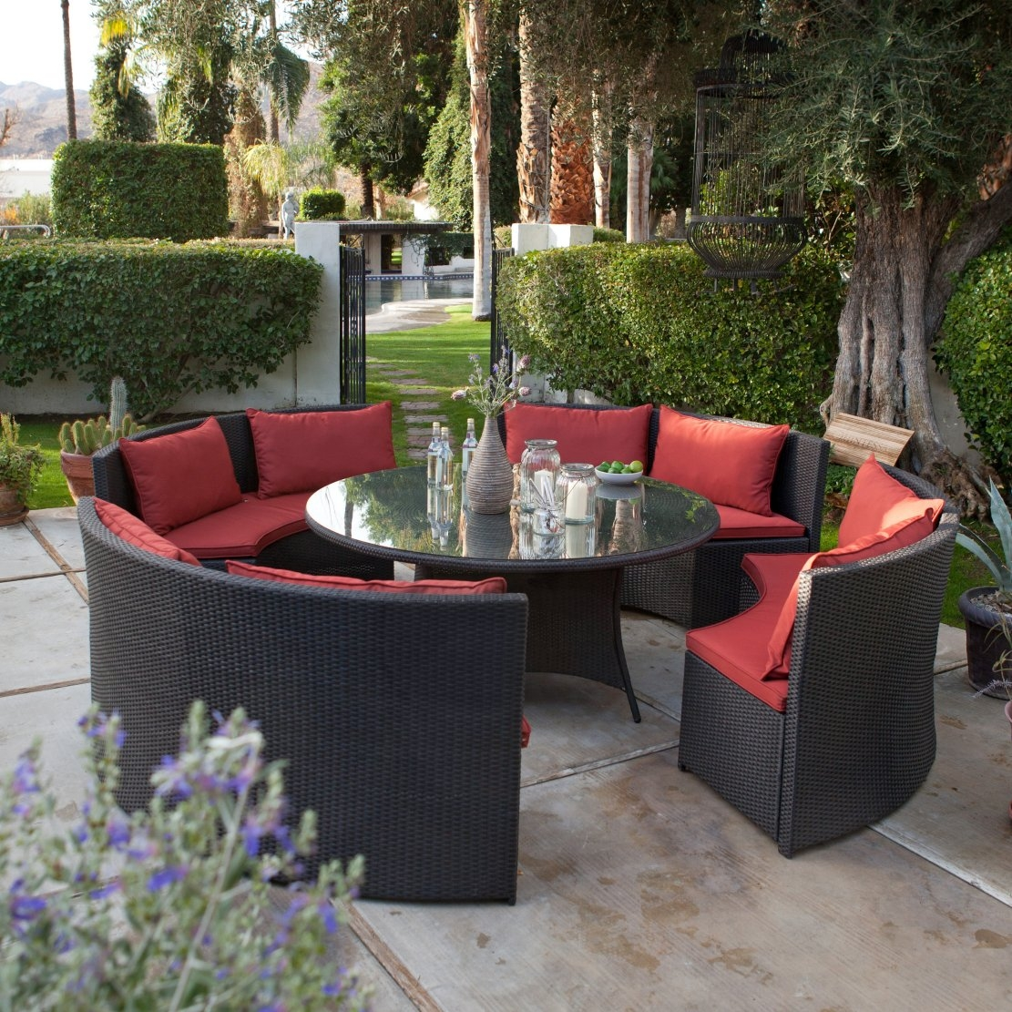 Modern 8-Seat Wicker Resin Patio Dining Set with Red Cushions, MWPD2499 :  Mix up some mojitos or a refreshing pitcher of lemonade, grab some friends, and prepare yourself for a night of fun and relaxation around this Modern 8-Seat Wicker Resin Patio Dining Set with Red Cushions- Seats 8. This head-turning contemporary set centers around a round dining table constructed of a lightweight frame of rust-proof aluminum with PVC-board top, and an all-weather wicker exterior with glass top. It's perfect for meals or informal get-togethers. As for seating, four cushioned benches offer a comfortable spot for eight people. Each bench is one quarter of a full circle, creating a round seating area that specializes in bringing people together. Each bench has a corrosion-resistant aluminum frame that's covered in all-weather wicker, and a set of matching Sunbrella cushions in choice of colors that will add the comfort you need outdoors. Aluminum frame with PVC board top for extra stability; Umbrella hole for optional added shade.