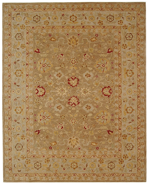 Handmade Ancestry Tan/ Ivory Wool Rug (9' x 12'), HATIWR9X10 : This Handmade Ancestry Tan/ Ivory Wool Rug (9' x 12') is made from hand-spun wool in tan and ivory. Crafted using an ancient, pot-dyeing technique, it features an Oriental design in accents of gold, red and green. All rug sizes are approximate. Due to the difference of monitor colors, some rug colors may vary slightly. We try to represent all rug colors accurately. Please refer to the text above for a description of the colors shown in the photo. Tip: We recommend the use of a non-skid pad to keep the rug in place on smooth surfaces. Style: Transitional; Primary color: Beige; Secondary colors: Gold, red and green; Pattern: Oriental.