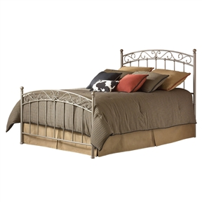 This Queen size Gentle Arch Metal Bed with Headboard and Footboard shows a refined poise perfect for anyone seeking simplicity with just a touch of character. The profile of the grill carries a gentle arch across the top with fanciful swirls just beneath. The simplicity of the vertical spindles make sure that the bed maintains a certain calm. One should note that each of these vertical elements is fixed into place with a solid casting. The footboard terminates at the bottom with another solid casting providing a very finished look. Its New Brown finish completes the bed.
