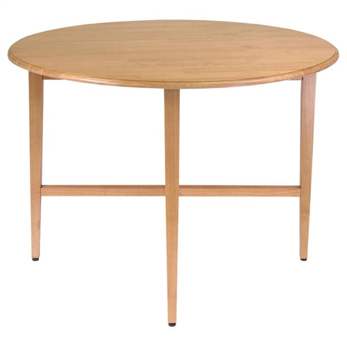 Drop-leaf tables are the perfect solution for small spaces, and with its simple style, this Round Drop Leaf Dining Table in Light Oak Wood Finish is ideal for apartments, studios, and small kitchens. It features two drop leaves that lift to extend the table to 42 inches in diameter; then just close the leaves for easy storage. This table is made from solid beech wood in a charming light oak finish, perfect for any decor. Assembly required. Dimensions (open): 42 diam x 29.5H inches.