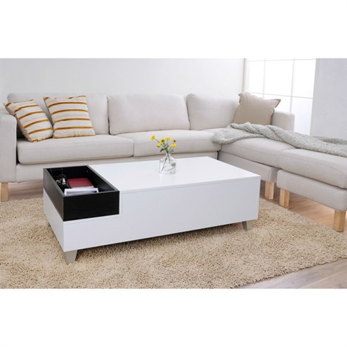 This White Modern Coffee Table with Accent Tray and Metal Legs is a modern table with a beautiful two-tone designs that will add beautiful balance and character to your living room. The clean, blocky lines and tapering silver feet give a naturally appealing look to your home. Exposed silver accent leg; ISTA 3A certified; Base: Solid; Design: Table; Features Options: Drawers, Tray Top; Product Category: Coffee & Cocktail Tables; Shape: Rectangle; Style: Modern/Contemporary.