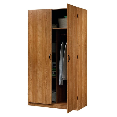 This Bedroom Clothes Closet Wardrobe Armoire in Medium Oak Wood Finish has hidden storage behind double doors. Two adjustable shelves. Garment rod included. This Product is of high Quality. A must buy Product.