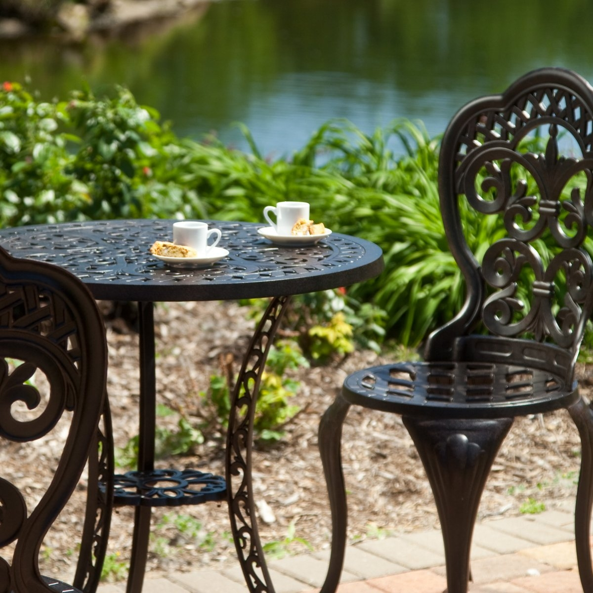 3-Piece Cast Aluminum Outdoor Bistro Set with Table and 2 Chairs, 3ABS21901 :  Perfect for breakfast on the balcony or for creating an intimate seating area in your garden, this 3-Piece Cast Aluminum Outdoor Bistro Set with Table and 2 Chairs makes a wonderful choice. With traditional fleur designs, this bistro set has the look of classic wrought iron sets, but it's made of cast aluminum so it won't rust like wrought iron. Some assembly is required. This table even has an umbrella hole! We recommend using a 6 or 7.5 foot umbrella with a 30-40 lb. umbrella base. Each piece is powder-coated for durability; Durable stainless steel hardware; Umbrella hole accommodates 1.5 inch poles; Assembly Required: Yes; Finish: Antique Wine; Seating: 2 - 3 Person; Style: Bistro Dining Sets; Table Shape: Round; Table Top Material: Aluminum.