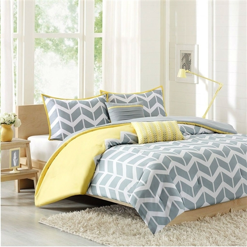 This Full/Queen 5-Piece Chevron Stripes Comforter Set in Gray White Yellow makes any bedroom fun and inviting. A gray and white chevron print runs along the comforter broken up by white vertical stripes. The reverse side is yellow adding charm and color to this comforter set. The same yellow borders the matching chevron print on the two shams. Includes the matching yellow and gray decorative pillows. Made of 100% polyester peach skin on the printed side and brushed polyester on the reverse; Fill Material: Polyester; Simple gray and white chevron with dreamy yellow accent reverses to solid gray; Coordinating textured gray and embroidered yellow decorative pillows; Machine washable; 200 gram polyester fill; Style: Contemporary / Modern.