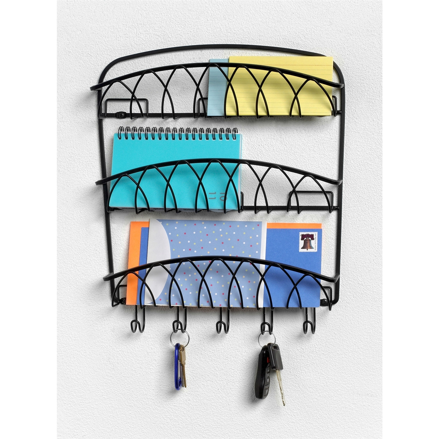 This 3-Tier Letter Holder Organizer with Key Hooks in Black Metal Finish would be a great addition to your home. It has a steel construction and a black finish. For convenient letter storage; Can be wall mounted; For hanging keys, jewelry and other small items; Wipe with damp cloth and towel dry.