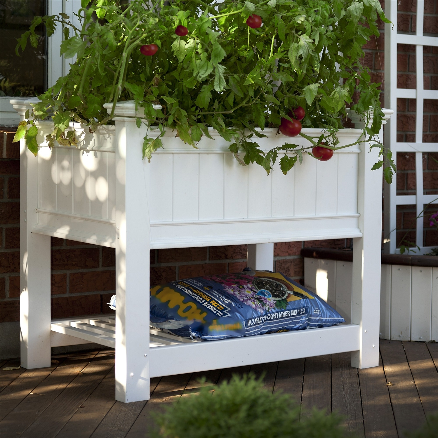 Elevated Planter Raised Grow Bed in White Vinyl, CRPW178 :  With this Elevated Planter Raised Grow Bed in White Vinyl you can grow perfect flowers and vegetables with less weeding, less pests and no soil compaction. Best of all, the Cambridge raised planter brings your garden to you. Attractively designed with architectural detailing to compliment any outdoor setting; the Cambridge Raised Planter even has a shelf to store pots, soil and gardening equipment. The Cambridge Raised Planter is strong and durable and will never need to be painted or stained. The occasional rinse with a garden hose is all you'll need to do to keep your planter box looking great year after year. This product comes with a 20 year manufacturer's warranty against yellowing, warping, cracking, and rotting. Maintenance free; Water Resistant: Yes Warp Resistant: Yes; Rot Resistant: Yes Crack Proof: Yes; Fade Resistant: Yes Anti-Shock: Yes; Number of Tiers: 1 Capacity: 131 gallons Ounces; Hardware Included: Yes Recycled Content: 0%; Eco-Friendly: Yes.