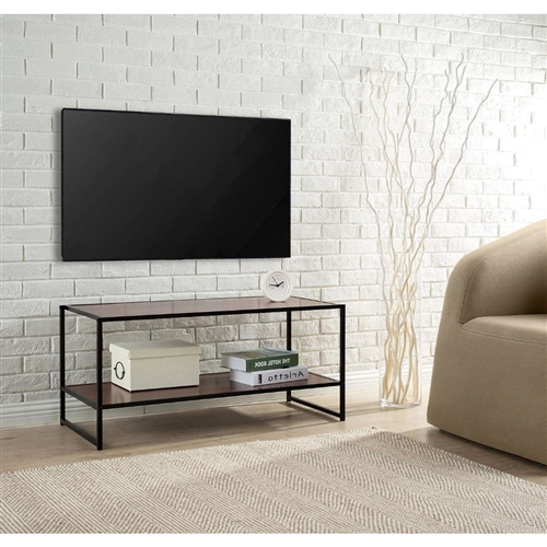 This Modern Design 40-inch TV Stand in Metal / Brown Wood Finish is an ideal combination of function and style. The TV Media Stand/ Table is functional for many purposes in your main living space. At 40 inches long it can accommodate a larger TV and includes an additional lower shelf for accessory and gaming storage. The sturdy, black square steel tubing and high-density panel with rich brown wood grain finish will add an elegant touch to any décor. Easy to assemble. Worry free limited 1-year warranty.