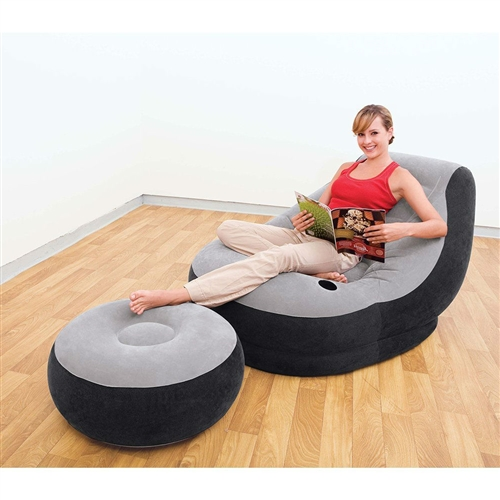 This clever, comfortable inflatable chair-and-ottoman set, features soft flocked material, an angled backrest, and built-in cup holder. The portable and surprisingly versatile furniture can be used camping, tailgating, relaxing around the house, and more, and it inflates in just minutes. Two-in-one valve has extra-wide openings for rapid inflation and deflation; Folds compact for easy storage or travel.