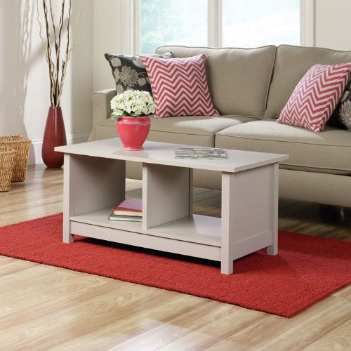 Whimsical without being fussy, this Light Grey Taupe Off-White Cocktail Coffee Table offers simple, clean forms in a mix and match color palette that is both soft and vibrant. Clean lines are complimented by deeply faceted drawer fronts and solid wooden knobs, craftsman like details that speak to the authentic origins of this collection. Open cubbyhole storage provides the perfect hideaway space for reading material, blankets, or board games. Whether your need is matchy matchy, mix and match, or unique room accent, Original Cottage in three colors - Cobblestone, Melon Yellow and Rainwater - is a modern classic that will add eye appeal to any home.