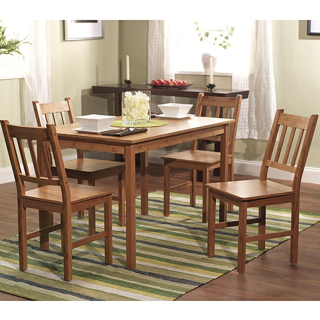 Made of eco-friendly, solid bamboo, this 5-Piece Eco-Friendly Solid Bamboo Dining Set will add a touch of elegance to your dining area. This table set features a beautiful natural finish and a durable construction.