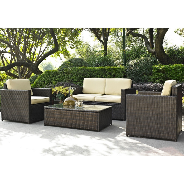 4-Piece Outdoor Wicker Resin Patio Furniture Set with Cushions, C4PFS76330 :  Set your ice cold beverage on the table and lounge around on this 4-Piece Outdoor Wicker Resin Patio Furniture Set with Cushions. Set includes loveseat, 2 arm chairs and tempered glass top cocktail table. Finely crafted with intricately woven wicker over durable aluminum frames, this timeless wicker furniture provides lasting comfort and style. Let your worries fade away as you doze off in our UV/fade resistant cushions. Use a soft clean cloth that will not scratch the surface when dusting. Use of furniture polish is not necessary. Should you choose to use a furniture polish, test in an inconspicuous area first. Use of solvents of any kind could damage your furniture's finish. To clean, simply use a soft cloth moistened with lukewarm water, then buff with a dry soft clean cloth.  Weather Resistant Details: Weather resistant; Detachable Cushion: Yes; Water Resistant Details: Water resistant; Assembly Required: Yes; Product Warranty: 3 Month limited; Frame Material: Aluminum; Woven Material: Resin wicker; Woven: Yes; Upholstery Material: Sunbrella. Weight Capacity: Chair: 250lbs. Individual Chair Weight Capacity: Loveseat: 250lbs. Included: Loveseat, 2 Arm chairs, Cocktail table; Country of Manufacture: China.  Chair Arm Width - Side to Side: 3.5 Inches; Chair Arm Height - Top to Bottom: 26 Inches; Table Width - Side to Side: 31 Inches; Seat Cushion Depth: 26.5 Inches; Seat Cushion Width: 23.5 Inches; Seat Cushion Thickness: 5 Inches.